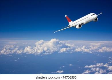 Large passenger plane flying in the blue sky