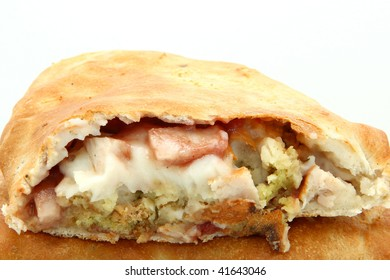 Large pastry filled with mashed potato, turkey, gravy, stuffing, cranberry sauce.