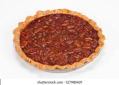 Large pecan pie in glass bakeware.