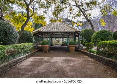 Large pergola set on a lovely leafy garden at the end of a wide walkway