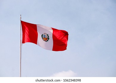 A large Peruvian flag waving in the wind.