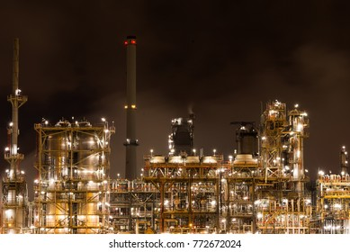 A large petrochemical plant at night.