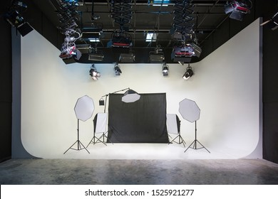 Large photography and video studios with white and black backgrounds and studio lights for arranging various forms of lighting With many sizes suitable for the job - Shutterstock ID 1525921277
