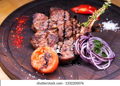 A large piece of lamb on the bone - restaurant dish - lamb grilled lamb grilled