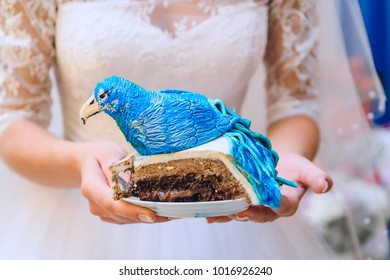 large piece of wedding cake blue bird cake