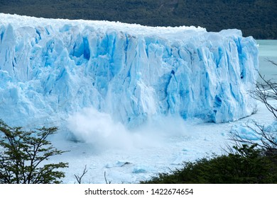Large pieces of blue ice falling down from Perito Moreno glacier. This is an ongoing natural process and not a result of global warming, as many people think. The sight and sound are spectacular