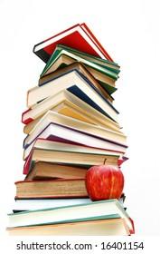 Large pile of books isolated on white background