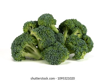 Large Pile of Broccoli on White Background