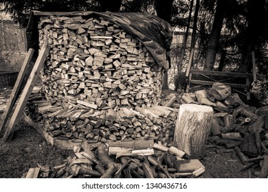 a large pile of chopped wood