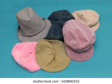 Large pile of colorful fashionable female hats