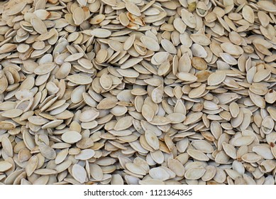Large pile of roasted pumpkin seeds usually sold on food markets