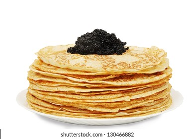 large pile of ruddy pancakes with caviar