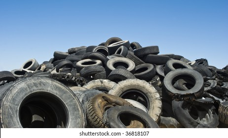 a large pile of used car and truck tires