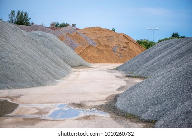 Large piles of construction sand and gravel used for asphalt production and building. Limestone quarry, mining rocks and stones