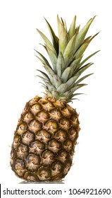 Large pineapple with crown of leaves isolated on white