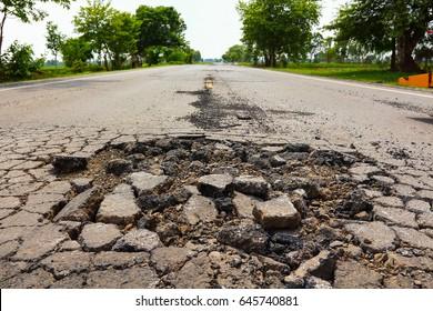 Large pit on asphalting highway.