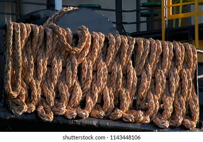 The large plaited mooring rope of the Port Vila ferry, carefully laid on the safety rails of the aft deck; glowing in the afternoon sunlight.