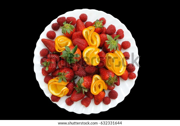 Large plate with strawberries and raspberries on holiday
