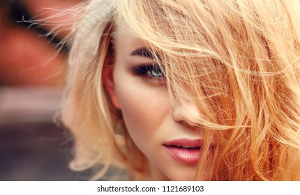 A large portrait of a blonde.  Cheeks, eyes, hair
