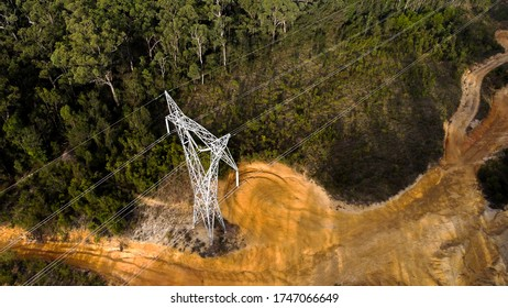 A large power line tower in the Australian bush