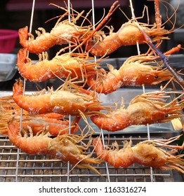 Large prawns are ready to be grilled at an outdoor market in Taiwan