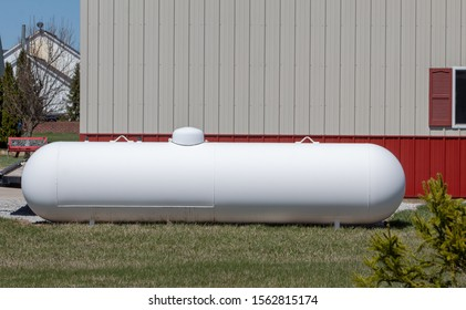 Large propane or liquid gas tank.