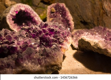 Large purple crystals of amethyst in a cave