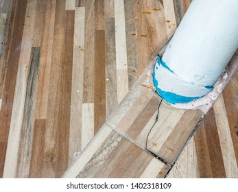 Large PVC pipe is embed in the tile floor for drainage the rain from the gutter of the urban house.