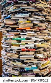 A large quantity of books stacked like a column