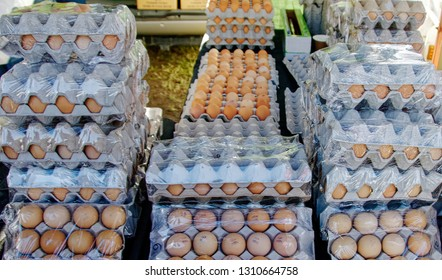 Large quantity of Fresh Farm Eggs displayed for sale at Gosford City Farmers Markets. Natural food. Commercial image suitable for background. NSW, Australia.