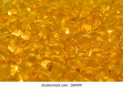 large quantity of vitamin e capsules.