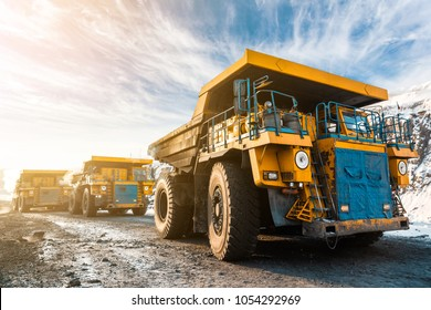 Large quarry dump truck. Loading the rock in the dumper. Loading coal into body work truck. Mining truck mining machinery, to transport coal from open-pit as the Coal. Production useful minerals.