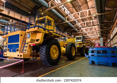 Large quarry dump truck. Loading coal into body work truck. Mining truck mining machinery, to transport coal from open-pit as the Coal. Production useful minerals.