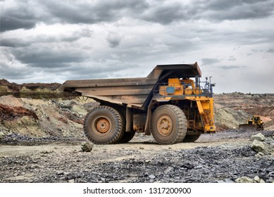 Large quarry dump truck. Loading the rock in the dumper. Loading coal into body work truck. Mining truck mining machinery, to transport coal from open-pit