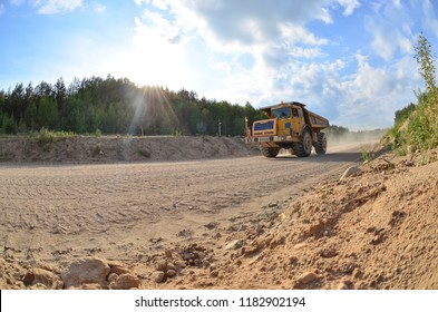 Large quarry truck. Loading the rock in the dumper. Loading coal into body work truck. Mining truck mining machinery, to transport coal from open-pit as the Coal. useful minerals. Belaz. Belarus