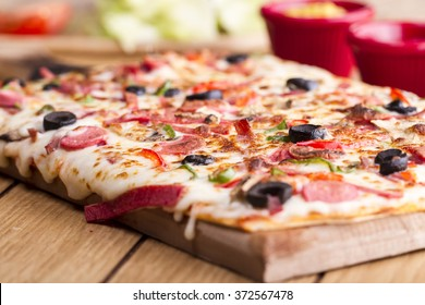 Large Rectangle Lavas Turkish  pizza on a wooden table. Restaurant