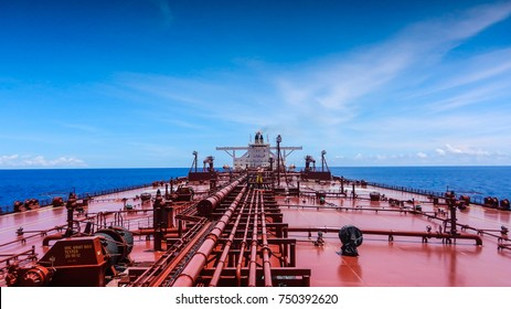 A large red crude oil tanker is sailing in the Indian Ocean