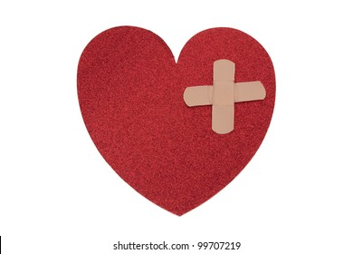 Large red heart with two bandages with copy-space isolated on white, Fixing a broken heart