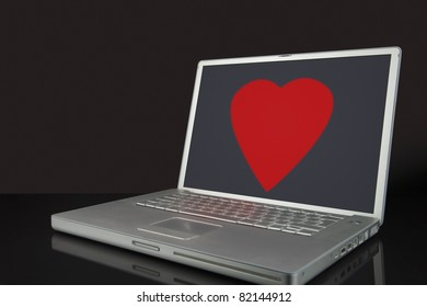 A Large red Love Heart on a laptop computer screen