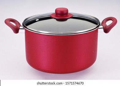 large red pot with glass lid and red details on white background