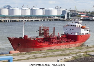 A large red ship just docked in the port of Ventspils, Latvia