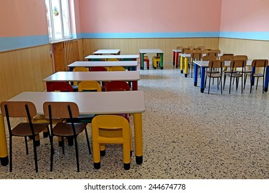 large refectory of kindergarten with small tables and chairs for children