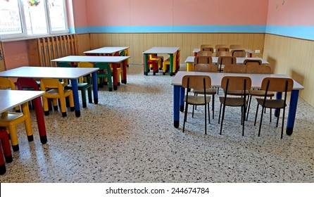 large refectory of kindergarten with tables and chairs for children