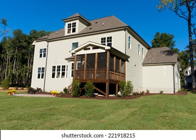 Large residential house with backyard porch and patio