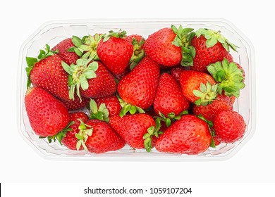 Large ripe strawberries from shop, in opened plastic box. Top view. Isolated on white background. Superstore ripe strawberries for sale, overhead shot. Strawberries from supermarket in container.