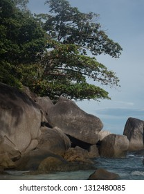 Large rock boulders in the water near the shore