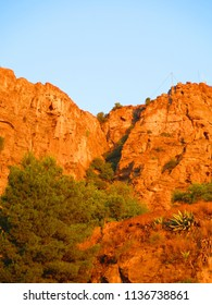 Large Rock face in early morning golden sunshine in Andalusia, Spain
