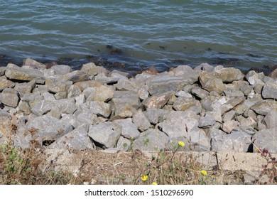 Large rocks along shoreline with sea