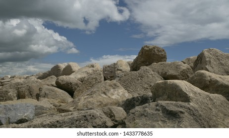 Large rocks on beach with cloudy Skys