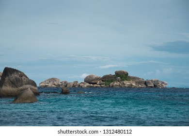 large rocks and small islands in the water